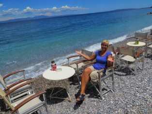 Niki drinking on the beachfront, again...